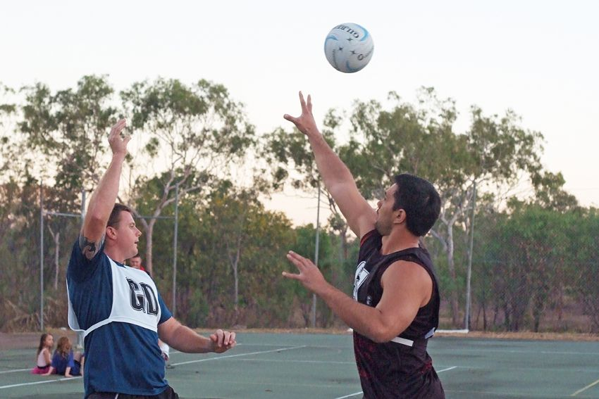 Action in the 2014 Jabiru Mixed Netball final with Joshua Healtie (left) from Reluctant Champs and Daniel Hill (right) from Kia Kaha.