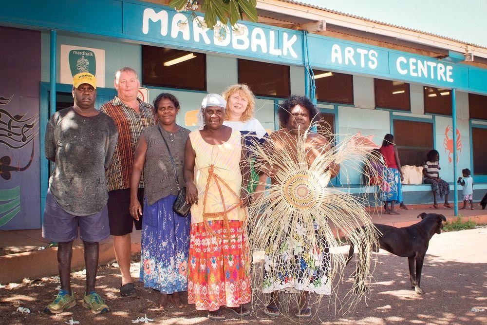James Gurruwiwi, Linda Najinga, Sandra Makurlngu, Lyn Narlbidgrra, Steve Westley and Brenda Westley outside the vibrant Mardbalk Arts Centre on Warruwi.